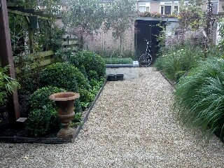 So clean. I love this (pea stone/gravel) Great way to enhance and define separate garden areas.