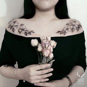 Flower chest tattoo for women - 65 Nice Chest Tattoo Ideas