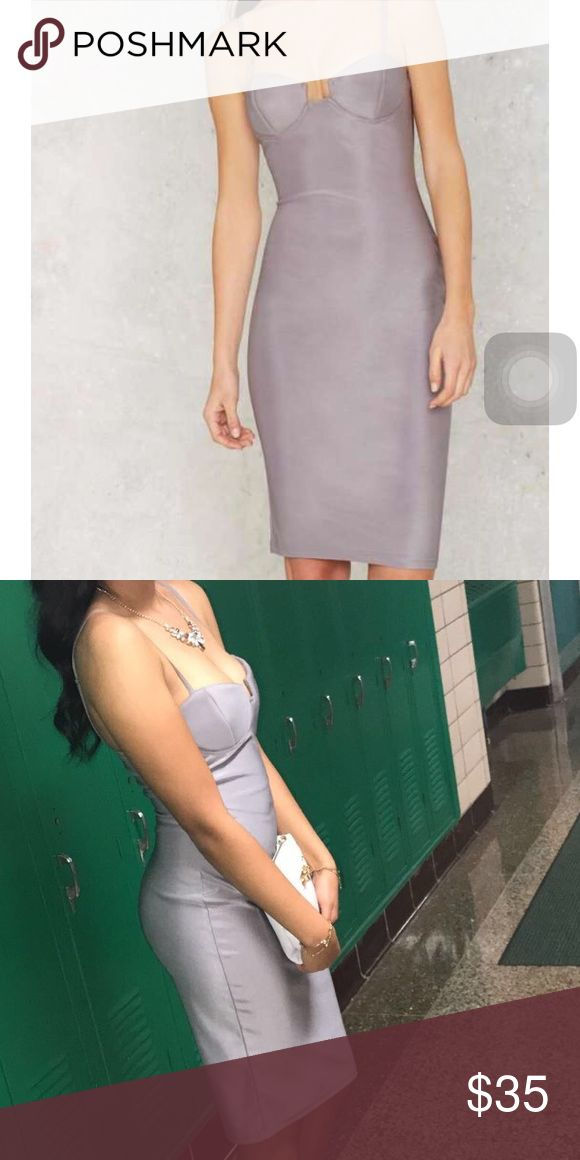 Silver Bodycon Dress😍 Silver-ish/grey bodycon dress Size:M (I wear a size 8 and it fit) Worn once to homecoming, dry cleaned Gold accent zipper on back of dress Rare London Dresses Midi