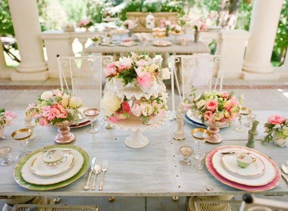 I really really love the idea of a Victorian tea party theme, in a garden...secret garden?