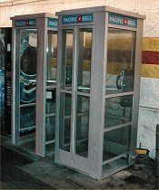 Fully enclosed telephone booths.