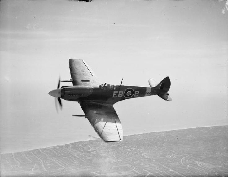 Spitfire F Mark XII, MB882 'EB-B', of No. 41 Squadron RAF based at Friston, Sussex, in flight over Eastbourne.