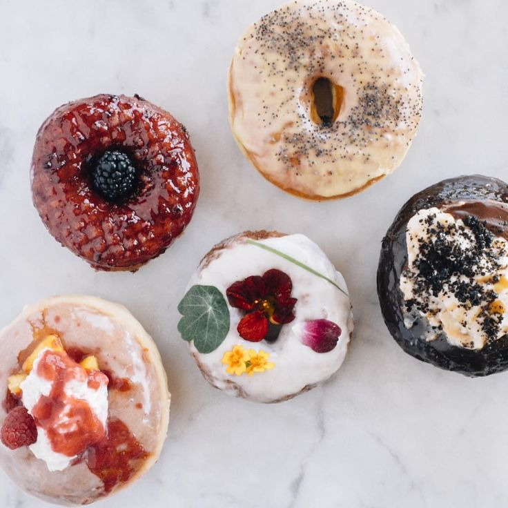 Unsettling but true - not only is it Monday, but it's also the last day of August...which means it's the last day for this month's Lemon Poppyseed, Blackberry, Chocolate Budino, Peach Melba, and Midsummer Garden Cake  Come and get 'em while you can! PC to @tawny xo #eatmoredoughnuts #summerflavors
