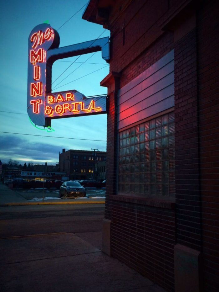 6. When you see this neon sign, step inside for a steak or a cocktail (or both).