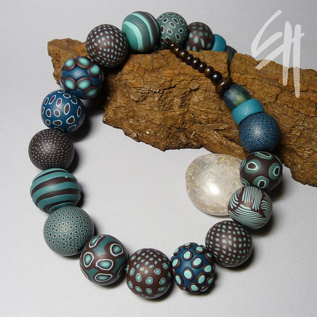Another great color combination of blues browns. The necklace by E.H.design, via Flickr