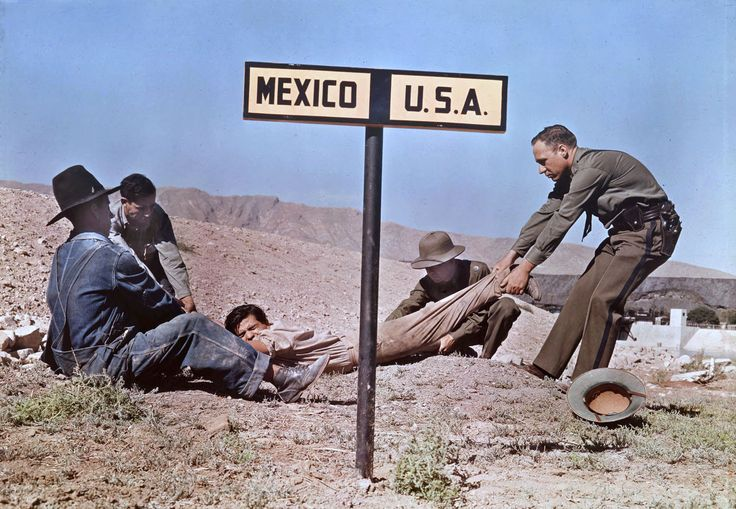 Two border patrol officers attempt to keep a fugitive in the U.S.A., near El Paso, Texas, 1939. Autochrome by Luis Marden.