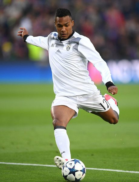 Alex Sandro of Juventus shoots while warming up prior to the UEFA Champions League Quarter Final second leg match between FC Barcelona and Juventus at Camp Nou on April 19, 2017 in Barcelona, Catalonia.
