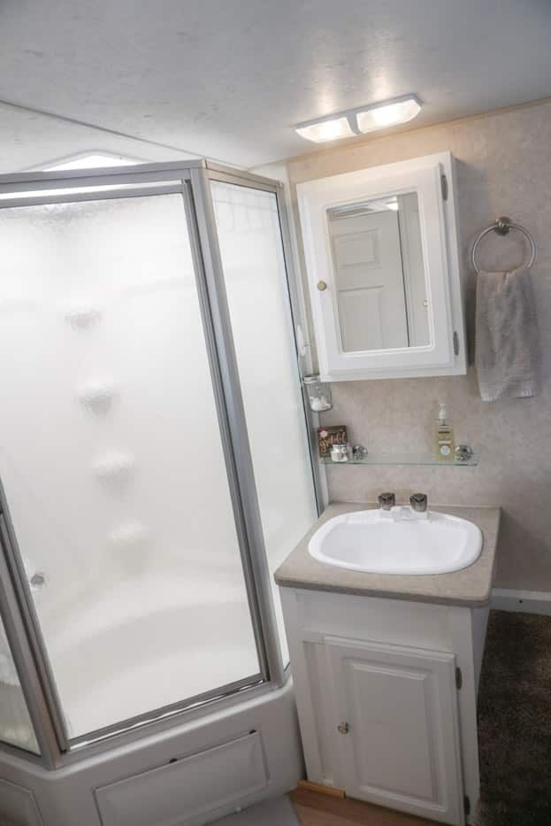 6 Quick Easy Remodel Projects That Transformed Our Rv Into A Home Corner Tub Shower Combo Tiny House Bathroom Corner Tub Shower