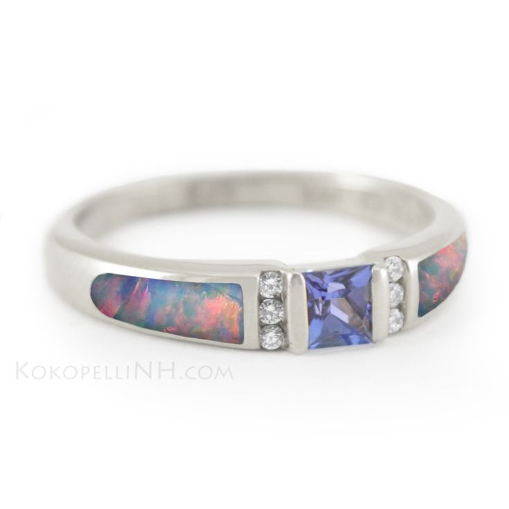 "We LOVE unique engagement rings! ""Moonlit Sea - Dream"" Engagement Ring with princess-cut Tanzanite, Red Opal inlay, and channel-set Diamonds. #bridaltransformed"