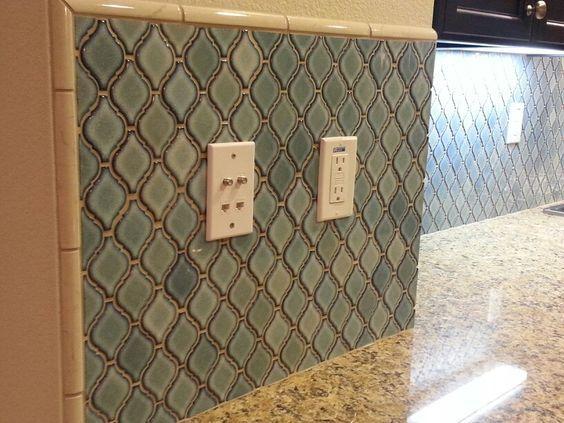 backsplash ideas with black cabinets and venetian gold granite kitchen | New Venetian Gold granite countertops with blue arabesque tile ...