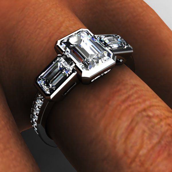Platinum three stone emerald cut diamond bezel engagement ring.. I like 3 stone but with a plain band
