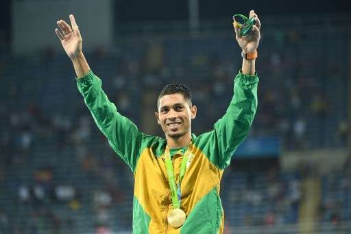 South Africa's Wayde van Niekerk (gold medal) celebrates during the podium…
