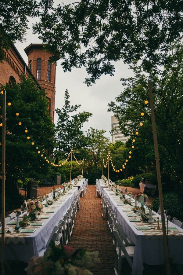 Lights strung over long farm tables | Jessica Love Photography