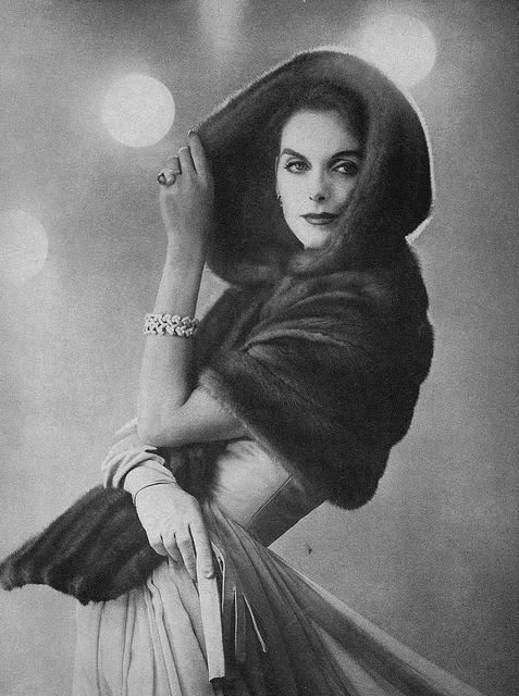 Anne St Marie, December Vogue 1956 Anne is wearing an Emba brown mutation mink coat by B. Wollman and a day length evening dress with a beige satin bodice and a beige chiffon skirt by Herbert Sondheim. Photographer Karen Radkai