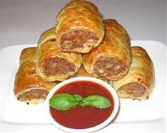 Simple Sausage Rolls Recipe - includes carrot & onion. I might even try grating a zucchini into the mix too.