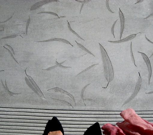Concrete with eucalyptus leaves imprints, front walkway of Room and Board store, San Francisco