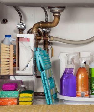 Kitchen cleaning supplies under sink