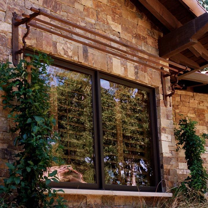 Above window iron trellis trellis pinterest for Window trellis design