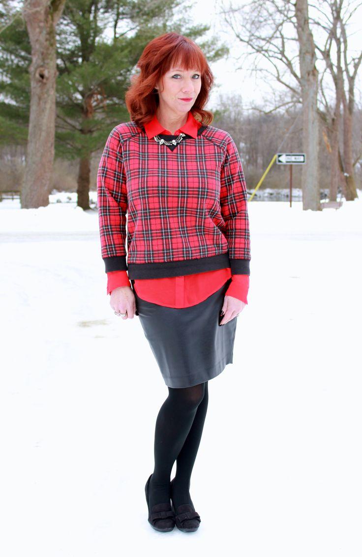 black faux leather pencil skirt, plaid sweatshirt, red blouse, black pumps, statement necklace