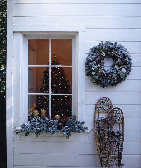Highlight your favorite window with a frost-bitten wreath and garland. It's the easiest way to ensure a white Christmas.