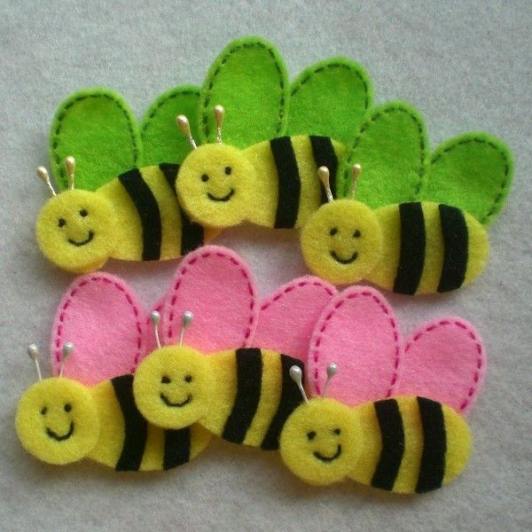 Handmade Bee Felt Applique (Light Yellow Body with Neon Green / Light Pink Wings). $5.10, via Etsy.