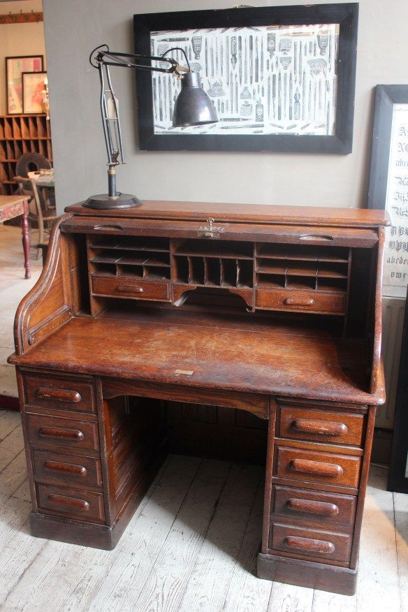 Roll top desk that looks almost exactly like the one in the basement. Golden oak I believe. Chair is in the grow room. Need to check to see if any of the antique keys fit this.