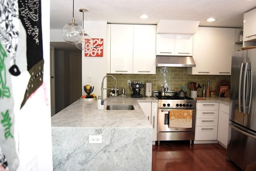 contemporary kitchen by Mid Mod Mom  * Interesting combo of tile back splash and marble counter. Funk-kay!