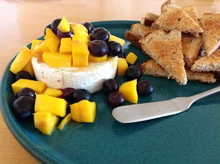 delish in a dish: Cedar-Planked Brie with Mangos and Berries
