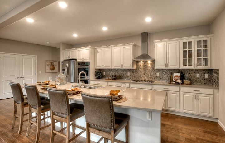 Don't the white cabinets in this home make you want to cook here TONIGHT?!