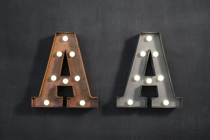 Marquee letter 'A' light bronze or zinc metal finish. Requies 2AA batteries.