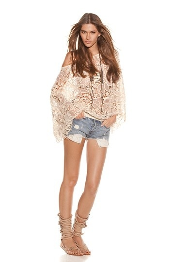 Not a fan of the shorts but the gladiator sandals and lace top are quite lovely