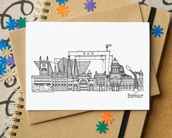 A blank card featuring an illustration of some of Belfasts greatest landmarks.  A great card for any Belfastian - as a birthday card, a notecard or maybe as a bon voyage card.  The illustration was drawn using pen and ink, by hand, and has then been digitally manipulated to come up with the final image. It features the Stormont, St Georges Market, Queens University, Titanic Belfast, the Crown Bar, the City Hall, the Palm House, Samson and Goliath, the Bigfish and the Beacon of Hope (aka…