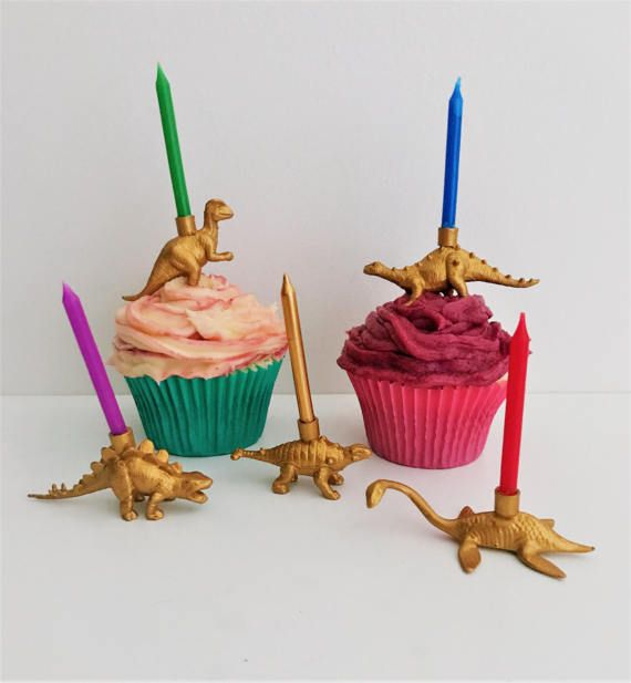 This gold dinosaur cake topper holds a candle on its back, it would be such a fun addition to any animal or zoo themed birthday party!