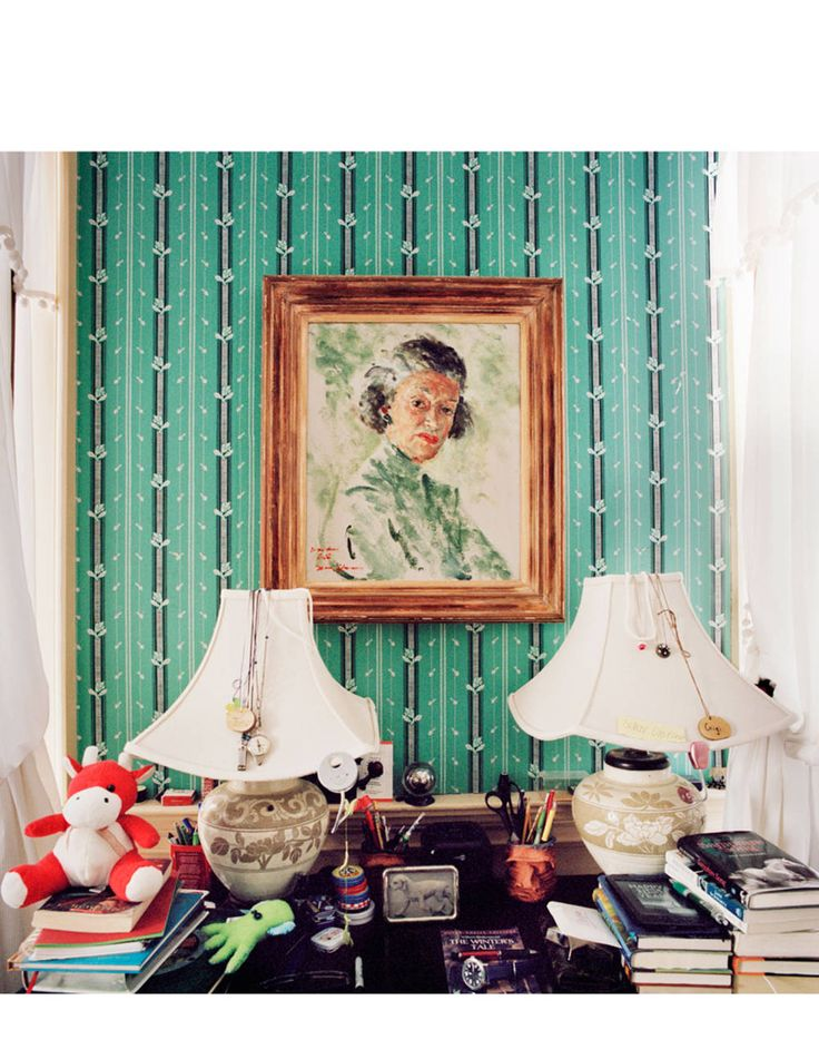 A portrait of Gertrude Sanford Legendre, Gigi and India's great-grandmother, keeps an eye on things in their bedroom.