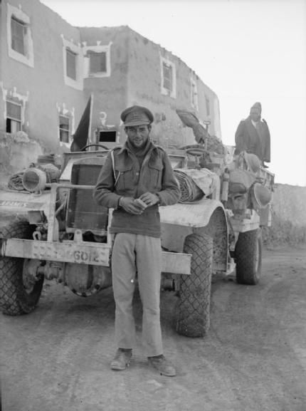 LONG RANGE DESERT GROUP LRDG DURING SECOND WORLD WAR (HU 25299) Object description Portrait of Captain David Lloyd Owen with Private 'Tich' Cave on the back of the 30 cwt truck behind, outside the Farouk Hotel in Siwa. Lloyd Owen joined the Yeomanry ('Y') Patrol of the Long Range Desert Group in mid 1941 and went on to lead it after the original Commanding Officer was wounded.