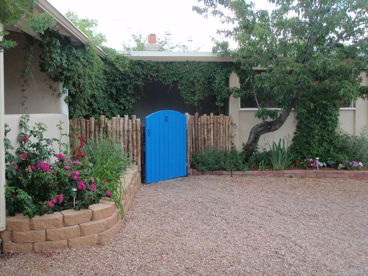 Front entry gate into courtyard and front door