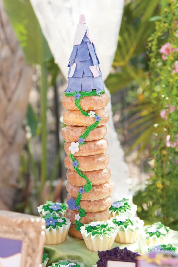 Um, I would have a Tangled themed birthday party just to have a glazed doughnut tower like this.