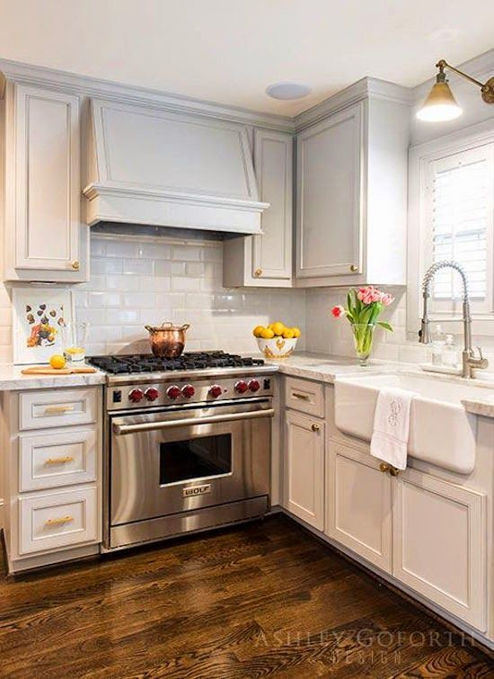Ashley GoForth Designs  I like the light fixture over the sink, the hood details and the backsplash.