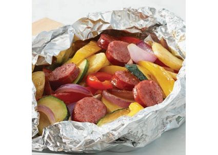 11 creative camp-food recipes that will make you forget you're roughin' it | HellaWella  A whole meal in an aluminum foil pouch! Before heading out on your camping trip, chop up some chicken sausage, potatoes, peppers and zucchini. Seal them in a foil pouch and cook over the fire for an easy, healthy dinner.