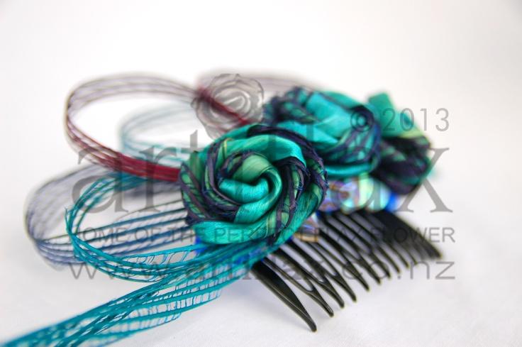Ocean coloured flax flower fascinator by Artiflax