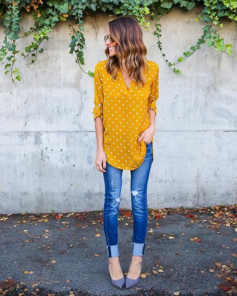 Sophisticated and chic! Playful and trendy! Our Della Polka Dot Top is all that and more. We love this adorable and chic dark mustard yellow blouse for your work to weekend styling.