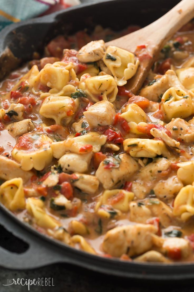 This Italian Chicken Tortellini Skillet is an en easy meal made completely in one pot -- loaded with roasted red peppers, spinach, tomatoes, herbs, cheese