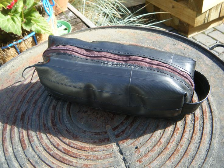 I made this pouch out of bike inner tubes. Thought I had invented it myself, but no... someone, somewhere else, was making them too. But I am still making them.