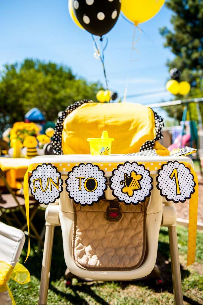Decorated high chair at a bumble bee first birthday party! See more party planning ideas at CatchMyParty.com!