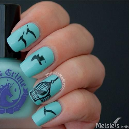 Bird and cage blue and black nail design
