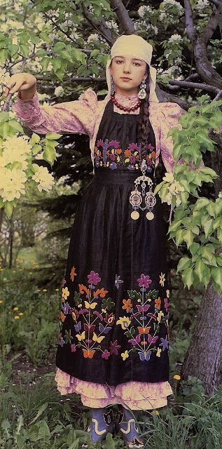 Tatar: love the embroidery with the Empire waist and the dangling doodads.
