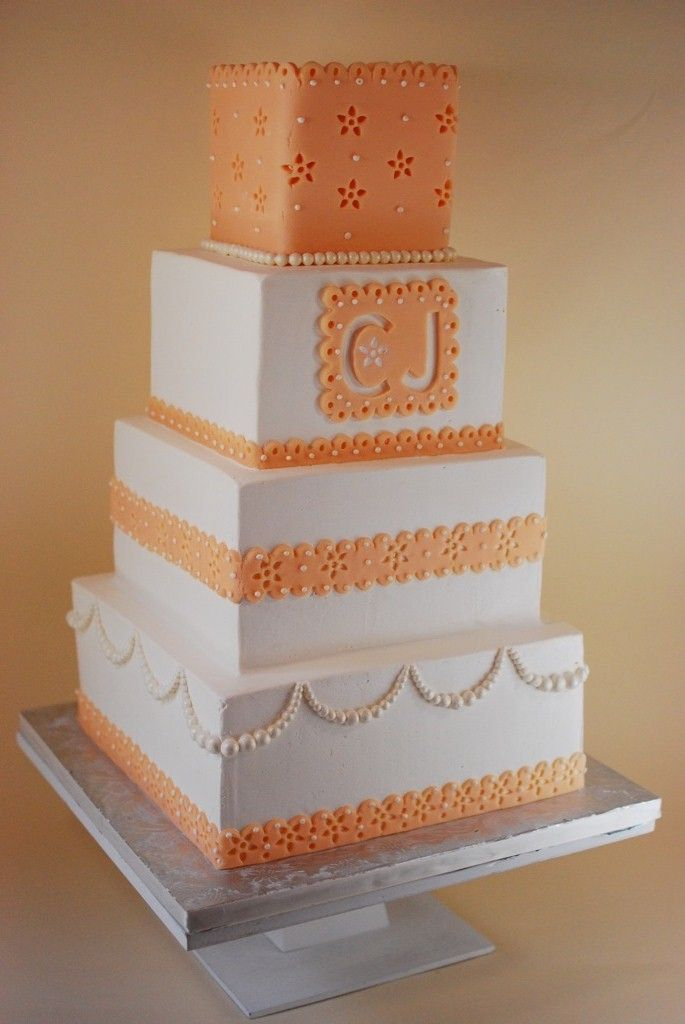 Cup a Dee Cakes Blog: Peach Monogram Eyelet Wedding Cake.  BUTTERCREAM with fondant accents.  The trick to this was using FONDARIFIC.