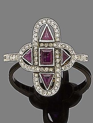 An Art Deco ruby and diamond ring, circa 1920. The quatrefoil-shaped plaque, pierced and collet-set with step and triangular-cut rubies, surrounded by rose-cut diamonds, to similarly-cut diamond shoulders. ~ETS