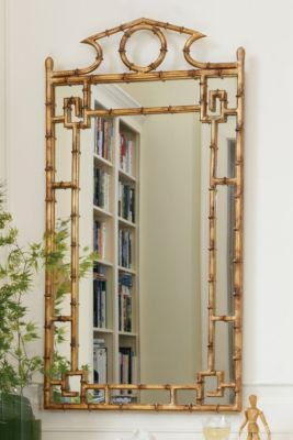 """Pagoda Mirror  Wrought iron frame. Frame has a gilded finish with a warm patina. Pagoda shape & bamboo references hearken back to classic chinoiserie. Mounting hardware included. 21""""w x 42""""h."""