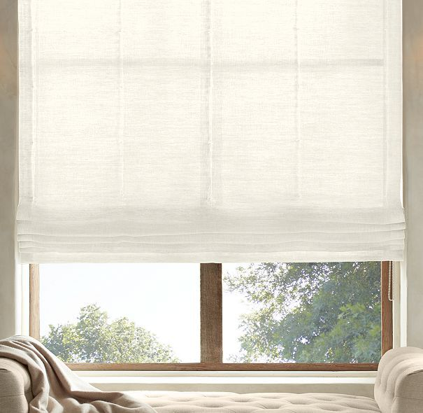 RH's Belgian Sheer Linen Flat Roman Shade:Highly functional and aesthetically clean, our custom Flat Roman Shades ensure that the windows themselves are part of the view. Sewn with a smooth front, they come in a variety of natural materials and fabric options that are also available in our drapery collections – allowing you to combine coverings in the same room, or even on the same window, with perfect ease. May also be layered over our Solar or Blackout Roller Shades.